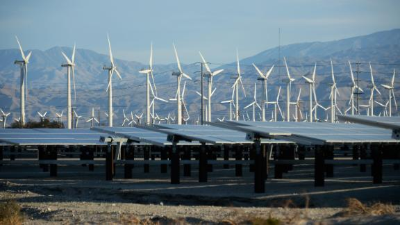 Power companies are increasingly switching to natural gas and renewable energy, such as these wind turbines and solar panels in Palm Springs, California.  (Photo by Kevork Djansezian/Getty Images)