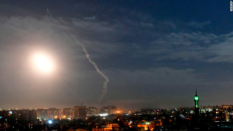 Missiles flying into the sky near international airport, in Damascus, Syria.