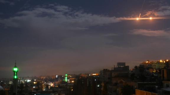 A picture taken early on January 21, 2019 shows Syrian air defence batteries responding to what the Syrian state media said were Israeli missiles targeting Damascus. - Israel struck what it said were Iranian targets in Syria today in response to rocket fire it blamed on Iran, sparking concerns of an escalation after a monitor reported 11 fighters killed. Israel openly claimed responsibility for the strikes against facilities it said belonged to the Iranian Revolutionary Guards' Quds Force, continuing its recent practice of speaking more openly about such raids. (Photo by STR / AFP)        (Photo credit should read STR/AFP/Getty Images)