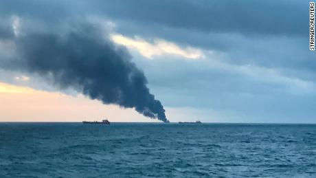 Smoke rises from ships in the Kerch Strait near Crimea on Monday.