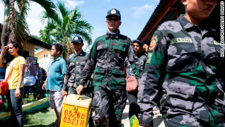 A policeman holds a ballot box on January 21, 2019, in a constituency in Cotabato, Mindanao, southern Philippines, in a vote to increase the nation's Muslim minority's control over the region.