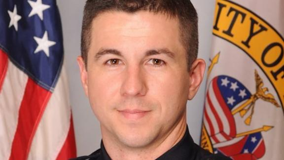 Sean Tuder, a Mobile, Alabama police officer, was shot and killed in the line of duty Sunday.