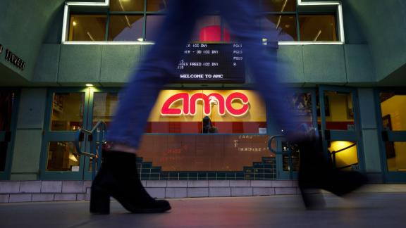 A pedestrians passes in front of an AMC Entertainment Inc. movie theater in Santa Monica, California, U.S., on Tuesday, Feb. 27, 2018. AMC Entertainment is scheduled to release earnings figures on March 1. Photographer: Patrick T. Fallon/Bloomberg via Getty Images