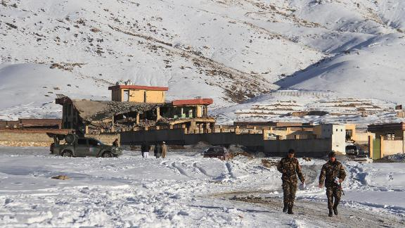 Afghan security forces walks near a site after a car bomb attack on a military base in the central province of Maidan Wardak on Monday.
