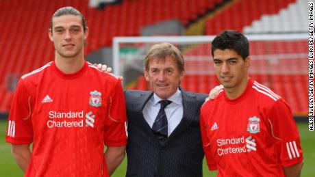 Andy Carroll (left) joined Liverpool at the same time as Luis Suarez (right).