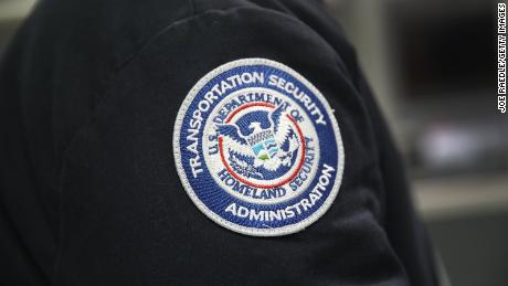 A patch is seen on the jacket of a Transportation Security Administration official as he works at the automated screening lanes funded by American Airlines and installed by the Transportation Security Administration at Miami International Airport on October 24, 2017 in Miami, Florida. (Joe Raedle/Getty Images)