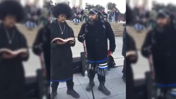 Another video shows members of the Hebrew Israelites agitating others in the crowd.