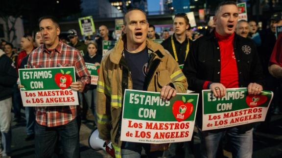 Firefighters marched Tuesday in support of Los Angeles teachers on strike.