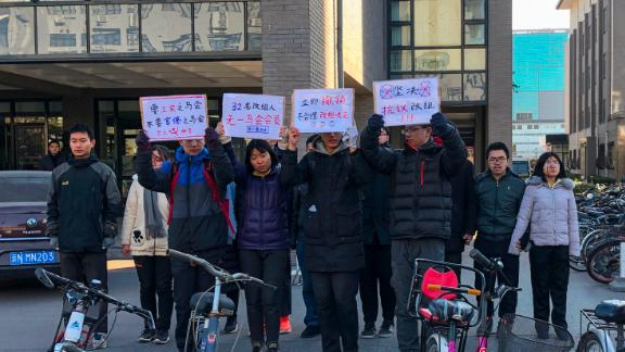 A group of students hold up signs as they protest against the change in a student-run Marxist group's leadership at Peking University in Beijing on December 28, 2018. - A dozen students from a top Chinese university staged the protest on December 28 after the school removed the president of an on-campus Marxist group amid an ongoing crackdown on student activists this year. (Photo by EVA XIAO / AFP)        (Photo credit should read EVA XIAO/AFP/Getty Images)