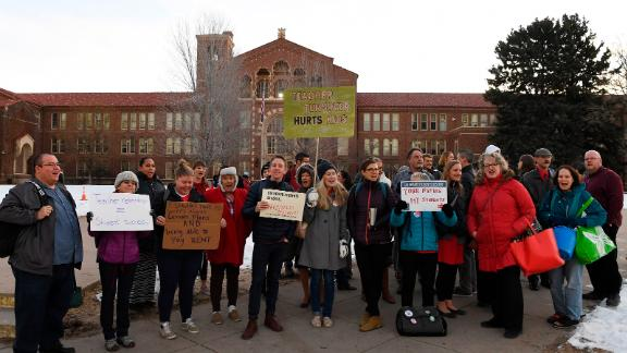 DENVER CO - JANUARY 15: Teachers at South High School picket, before school starts, asking for a wage increase on January 15, 2019 in Denver, Colorado. Bargaining negotiations between Denver Public Schools and the teacher's union carry on this week with a vote at the end of the week to determine whether Denver teachers will strike. (Photo by RJ Sangosti/The Denver Post via Getty Images)