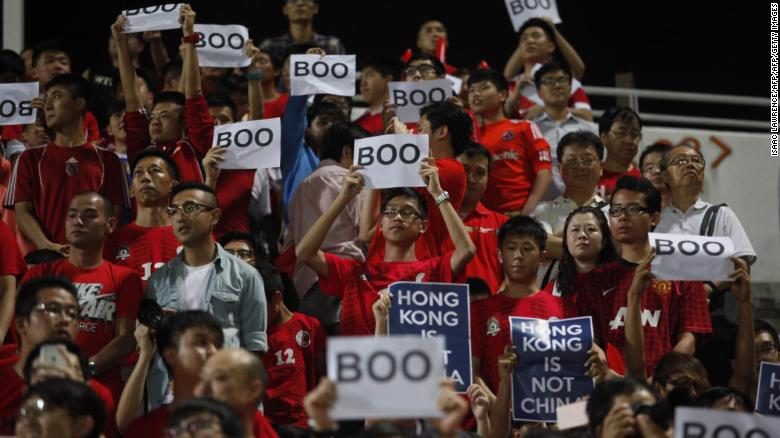 "Hong Kong fans hold up signs that read ""Boo"" while the national anthem was being played during a world cup qualifier at Mong Kok stadium in Hong Kong on November 17, 2015."