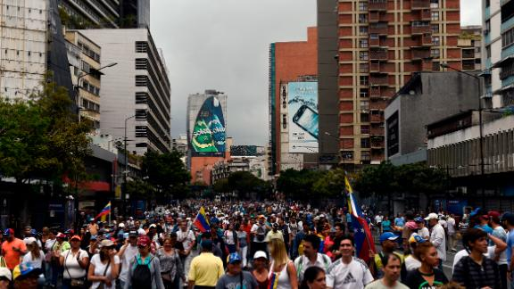 Opposition supporters take part Wednesday in a Caracas march on the anniversary of a 1958 uprising.