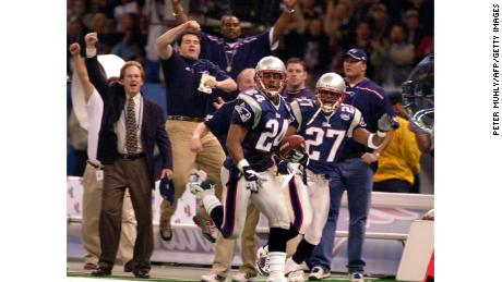 Patriots corner back Ty Law after intercepting Warner's pass during first-half action.