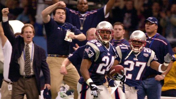 Patriots corner back Ty Law after intercepting Warner