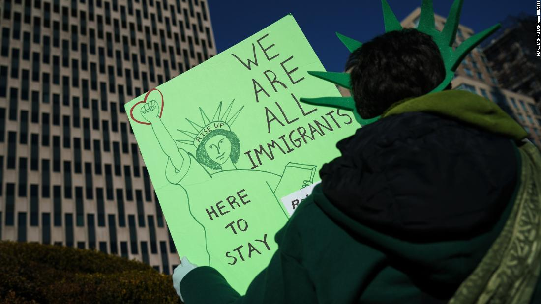 Trump nabs win on rule that could reshape legal immigration but hold remains in place