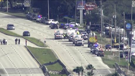 A large number of police cars and ambulances respond to SunTrust Bank in Sebring, Florida.