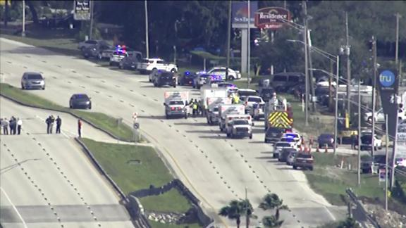 Police vehicles and ambulances respond to the SunTrust bank branch Wednesday in Sebring, Florida.
