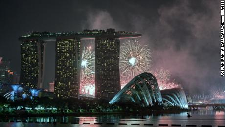 Fireworks burst over the skyline during a preview for the 50th Singapore National Day celebration on August 1, 2015.