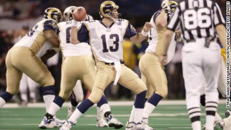 Rams quarterback Kurt Warner, who won Super Bowl XXXIV in 2000 against the Titans, was back in his second championship game.