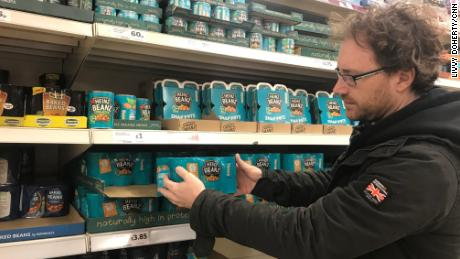 Graham Hughes stockpiles Heinz baked beans for his family at the supermarket.