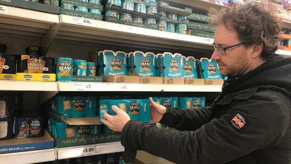 Graham Hughes stockpiles Heinz baked beans for his family at the supermarket.
