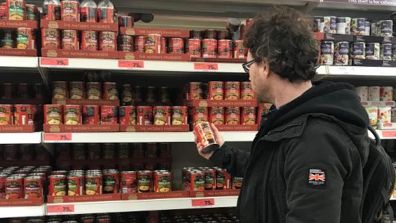 Graham Hughes stocks up on canned foods.