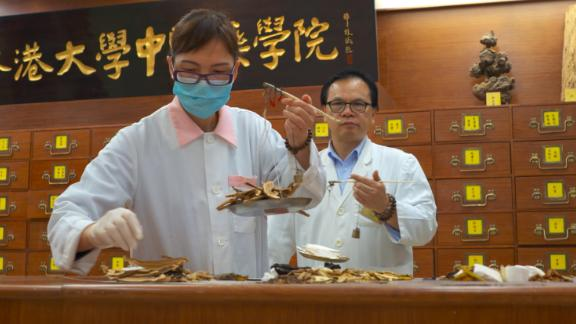 Professor Lao Li Xing trains younger generations to carry on the ancient practice of traditional Chinese medicine