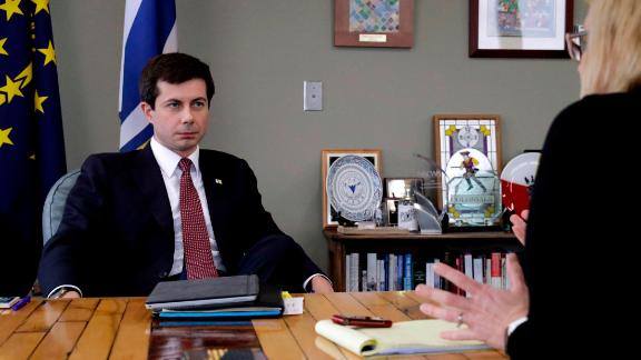 Mayor Pete Buttigieg listens to an AP reporter at his office in South Bend, Ind., Thursday, Jan. 10, 2019.  Few people know Pete Buttigieg