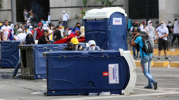 Demonstrators in Caracas protest Maduro