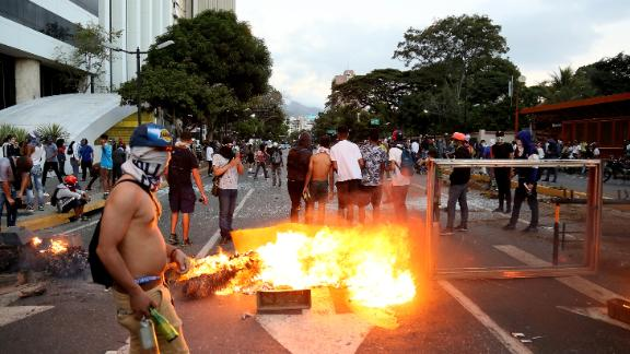 A fire burns during a protest Wednesday in Caracas against Maduro's government.
