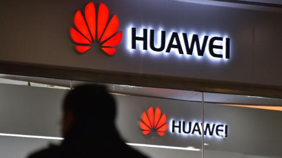 "A man walks past a Huawei store in Beijing on December 10, 2018. - China on December 10 protested Canada's ""inhumane"" treatment of an executive of telecom giant Huawei who is being held on a US extradition bid, following reports she was not getting sufficient medical care. (Photo by GREG BAKER / AFP)        (Photo credit should read GREG BAKER/AFP/Getty Images)"