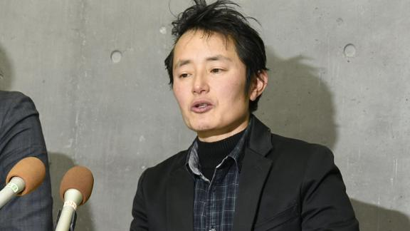 """Takakito Usui speaks to reporters after the Supreme Court ruled a law that effectively forces trans people to be sterilized is """"currently constitutional."""" The 45-year-old wished to register as a male without undergoing surgery."""
