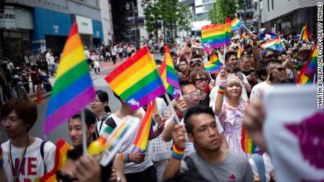 People attend the annual Tokyo Rainbow Parade in May 2018. Japan has made limited progress on LGBT rights, but activists warn significant hurdles remain.