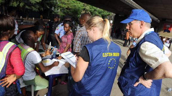 European Union observers take notes as officials of Independent National Electoral Commission (INEC) count ballots during gubernatorial and local assembly elections in Lagos on April 11, 2015.  Nigeria began counting votes from state governor and local assembly elections on April 11, with the main opposition party tipped to build on its historic victory in the presidential race.  AFP PHOTO / PIUS UTOMI EKPEI        (Photo credit should read PIUS UTOMI EKPEI/AFP/Getty Images)