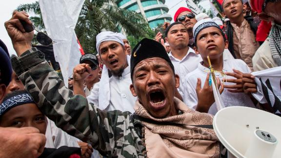 Members of various hardline Muslim groups celebrate after Jakarta's Governor was convicted of committing blasphemy on May 9, 2017 in Jakarta, Indonesia.