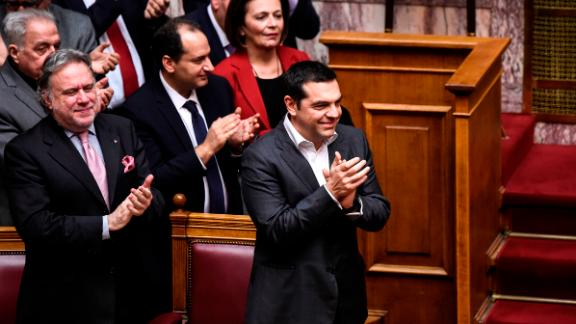 Greece's Prime Minister Alexis Tsipras celebrates after the Prespa Agreement is ratified in the Greek Parliament on Friday.
