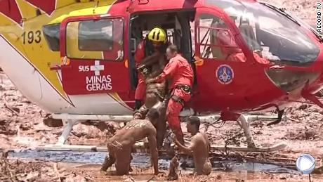 A helicopter crew makes a dramatic rescue Friday in southeastern Brazil.