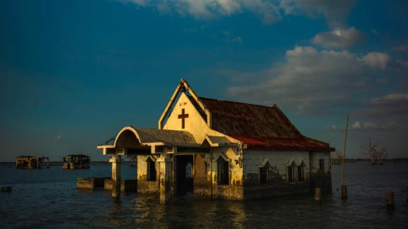 BULACAN, PHILIPPINES - NOVEMBER 27:  Sea water engulfs the church of Pariahan village  and the road leading to it, on November 27, 2018 in Bulacan, north of Manila. Pariahan used to be a bustling small village known for its serene beauty and its flamboyant fiestas. When tropical cyclone Nesat hit the country in 2011, the village was submerged in sea water and remained as such years after. Now, the villagers of the once beautiful village of Pariahan is slowly being washed away by the sea with its inhabitants have to bear living without land.   A recent climate study by the United Nations has warned that the world has 12 years to limit rising temperatures and an additional half-degree Celsius would eventually lead to floods, droughts, extreme heat, and rising ocean levels that will impact hundreds of millions of people. According to experts, local economies would eventually take a major toll as hotter temperatures threaten forests and coastlines while depleting fisheries and agriculture, eradicating the oceans coral, and fueling food shortages, while a UN report released in March this year projected that all commercial fishing in the Asia-Pacific region could cease within 30 years if no actions against climate change are implemented. (Photo by Jes Aznar/Getty Images)