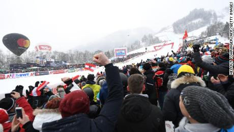 Ski racing fans watch the famous Kitzbuhel downhill.
