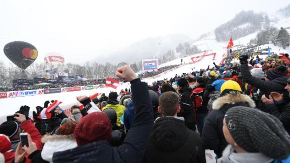 Ski racing fans watch the famous Kitzbuhel downhill.
