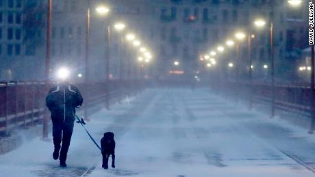 A runner and his dog brave frigid conditions Thursday while making their way east across the Stone Arch Bridge in Minneapolis.
