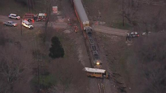 After the collision, the train pushed the school bus down the track.