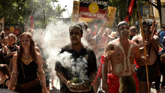 """People take part in an """"Invasion Day"""" rally on Australia Day in Melbourne on January 26, 2018."""