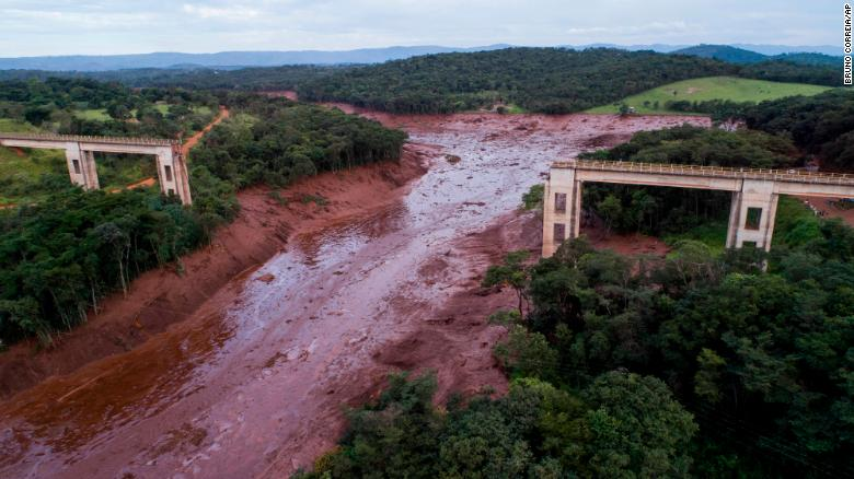 An aerial view shows a collapsed bridge after flooding from a dam collapse Friday in southeast Brazil.