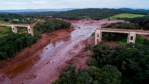 An aerial view shows a collapsed bridge caused by the burst dam.