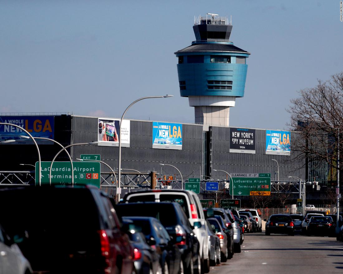 "The air traffic control tower at New York's LaGuardia Airport on January 25. The Federal Aviation Administration reported delays in air travel because of a ""slight increase in sick leave"" at two East Coast air traffic control facilities."