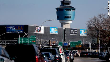 "The air traffic control tower at LaGuardia Airport is seen, Friday, Jan. 25, 2019, in New York. The Federal Aviation Administration reported delays in air travel Friday because of a ""slight increase in sick leave"" at two East Coast air traffic control facilities.  (AP Photo/Julio Cortez)"