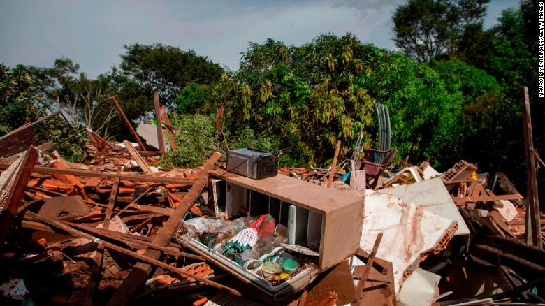 Debris is widespread Saturday in the Parque da Cachoeira community after the dam collapse.