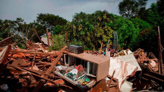 Debris is widespread Saturday in the Parque da Cachoeira community after the dam collapse.
