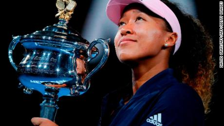 Japan's Naomi Osaka celebrates with the championship trophy during the presentation ceremony after her victory against Czech Republic's Petra Kvitova.